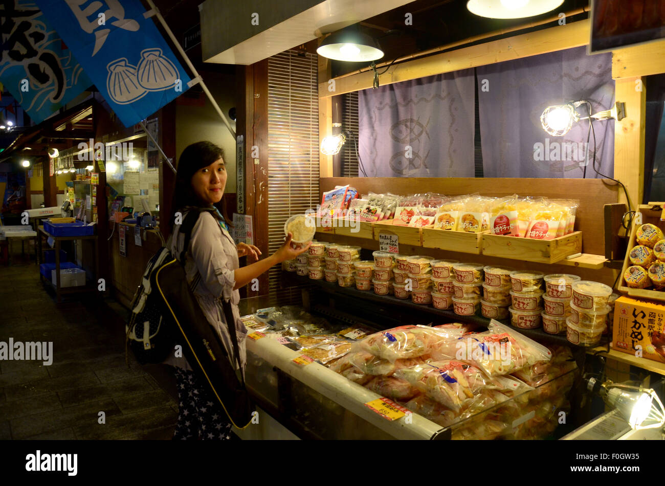 Thai woman buying traditional Japanese food (seafood and sushi) at