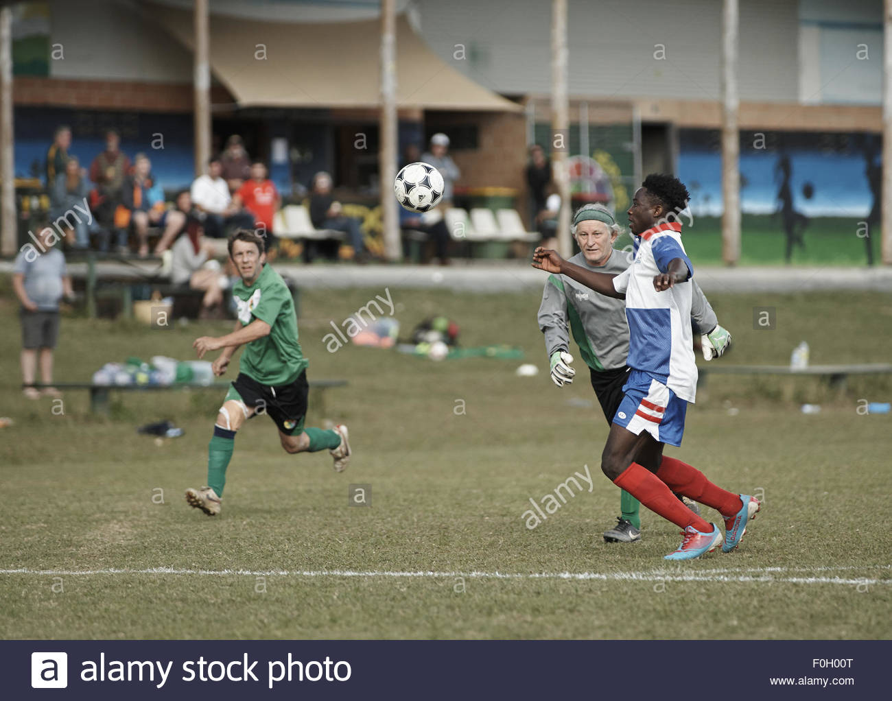 beaten the goalie, at a weekend football match; at the nimbin headers soccer club - Stock Image