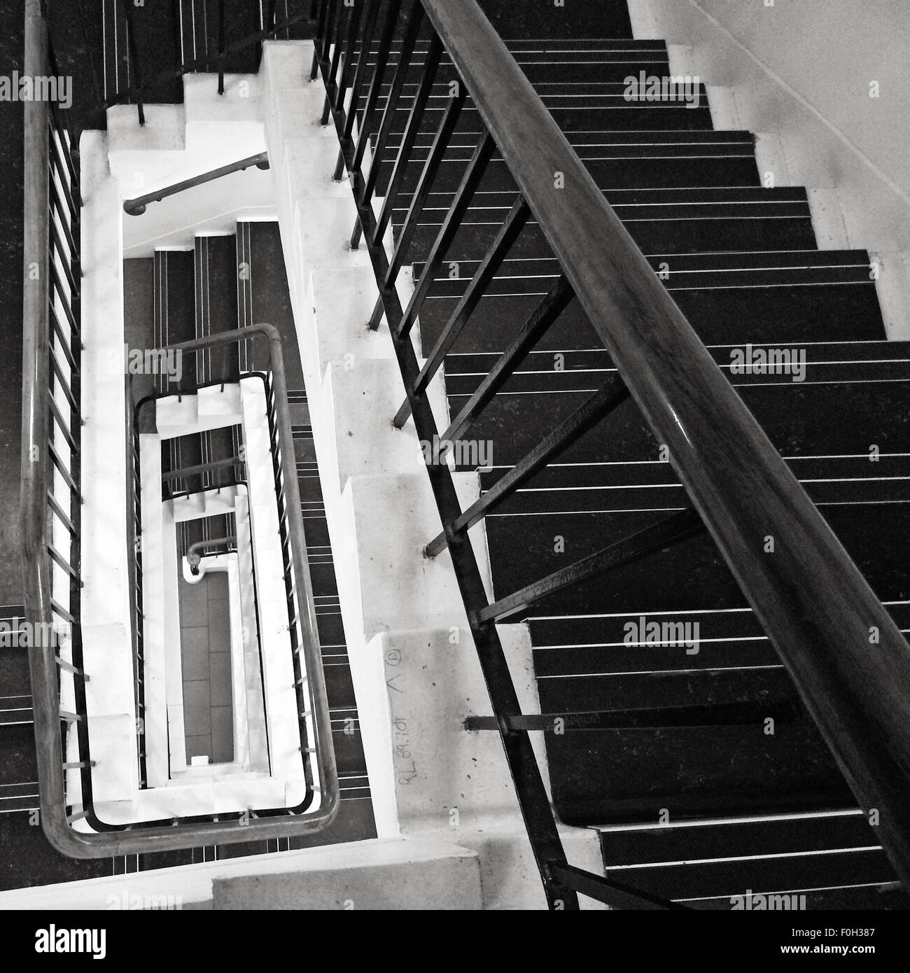 Rectangular staircase  looking down with sense of perspective and vanishing point (BW) - Stock Image