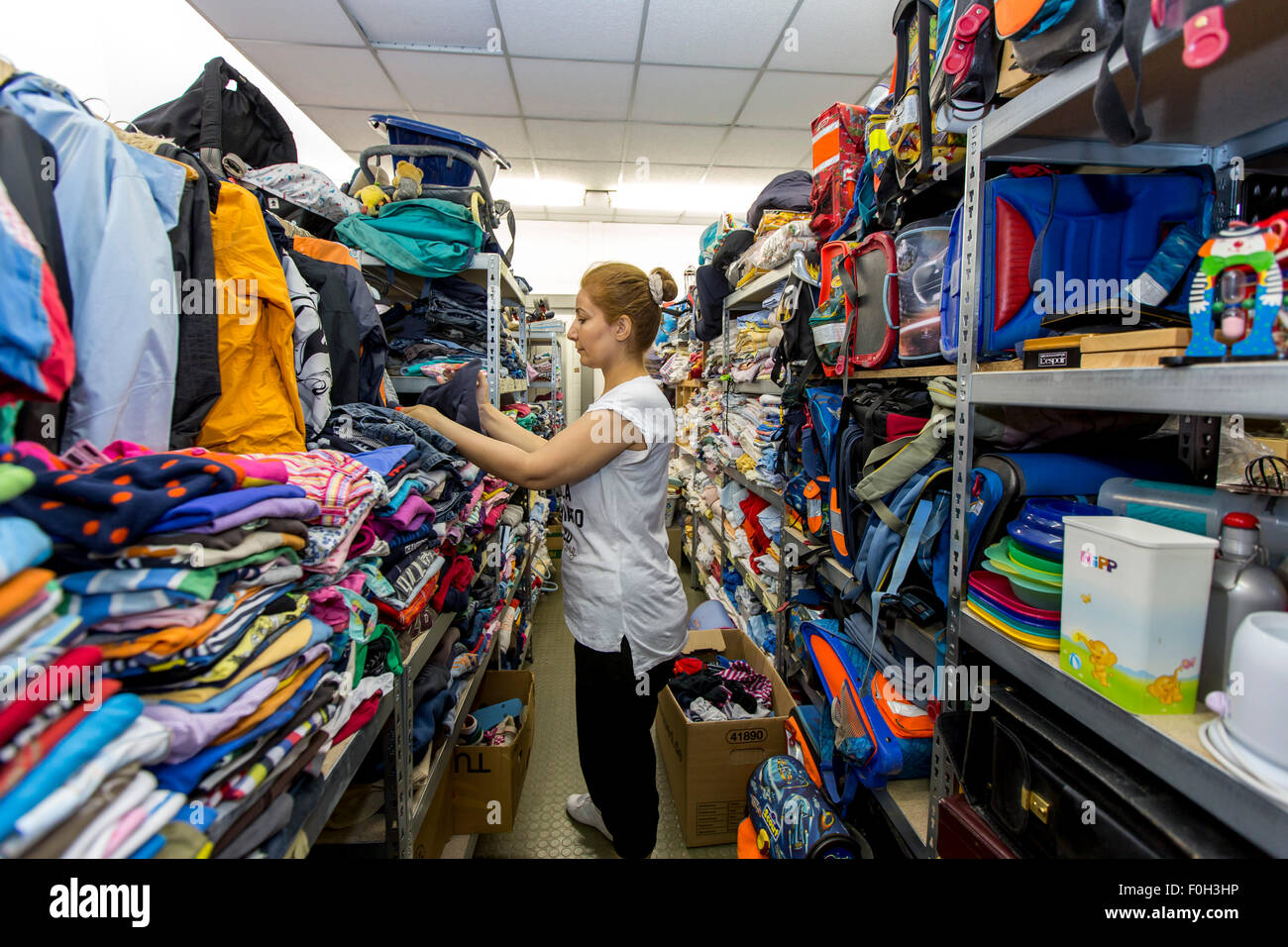Warehouse for refugees from Syria and other countries, donations of all kinds, by locals, are given to the refugees - Stock Image