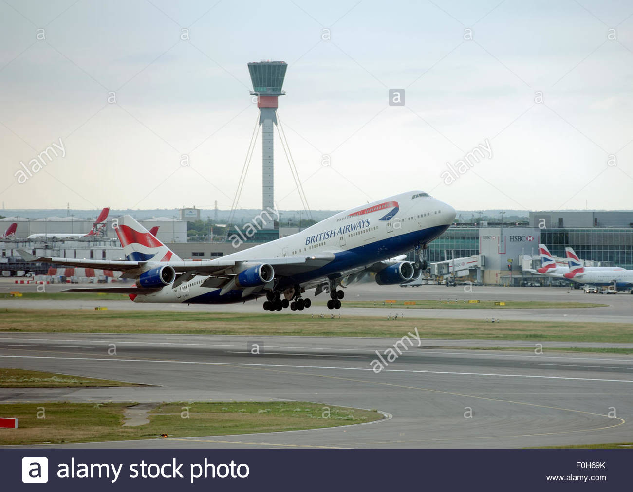 London UK. British Airways Boeing 747 G-BNLY aircraft taking off from London Heathrow Airport. - Stock Image
