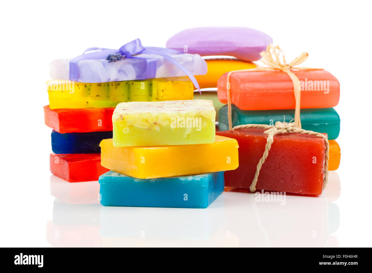 Stack of new colorful Soap Bars on white background. - Stock Image