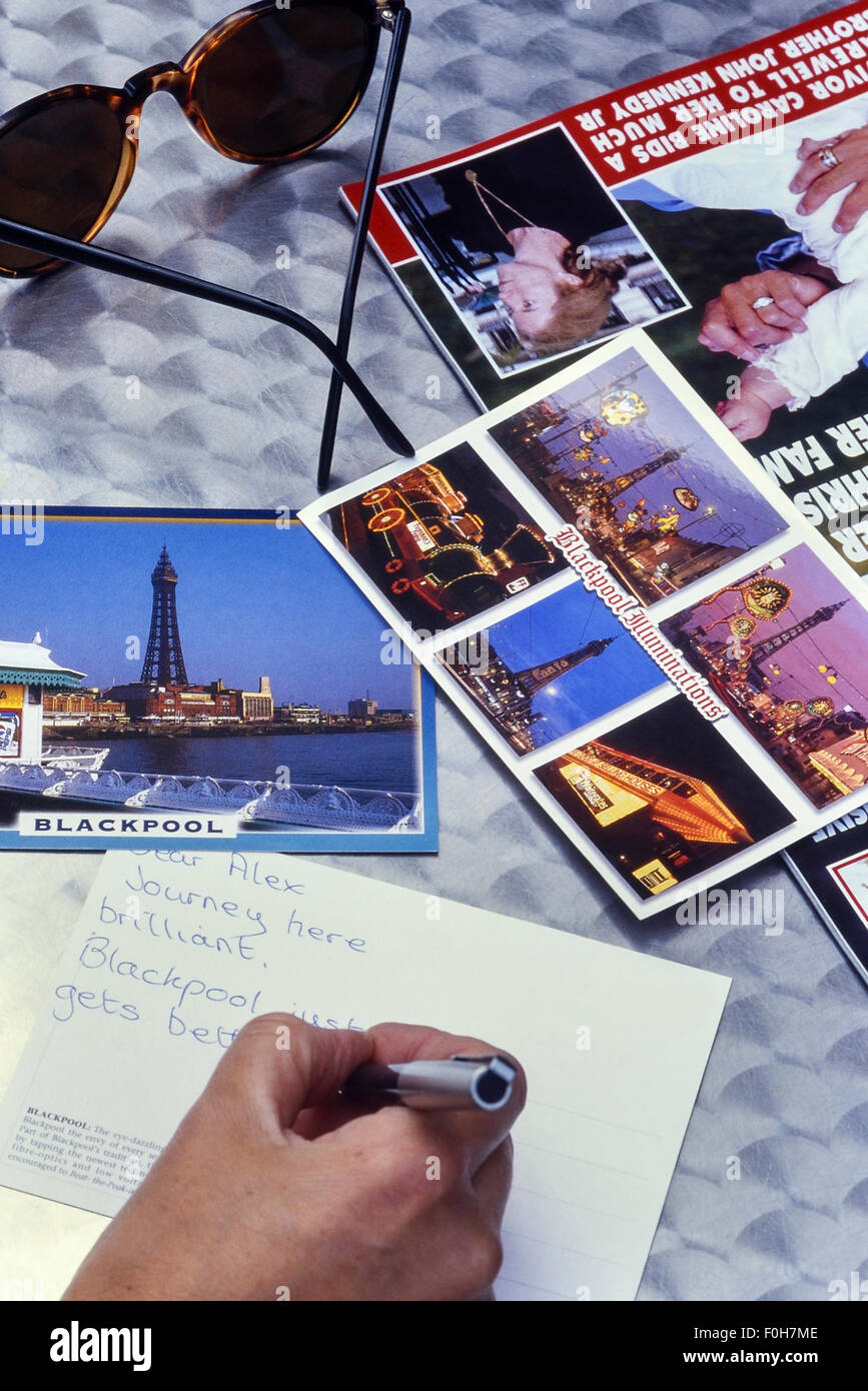 Writing a postcard from Blackpool. Lancashire. UK - Stock Image
