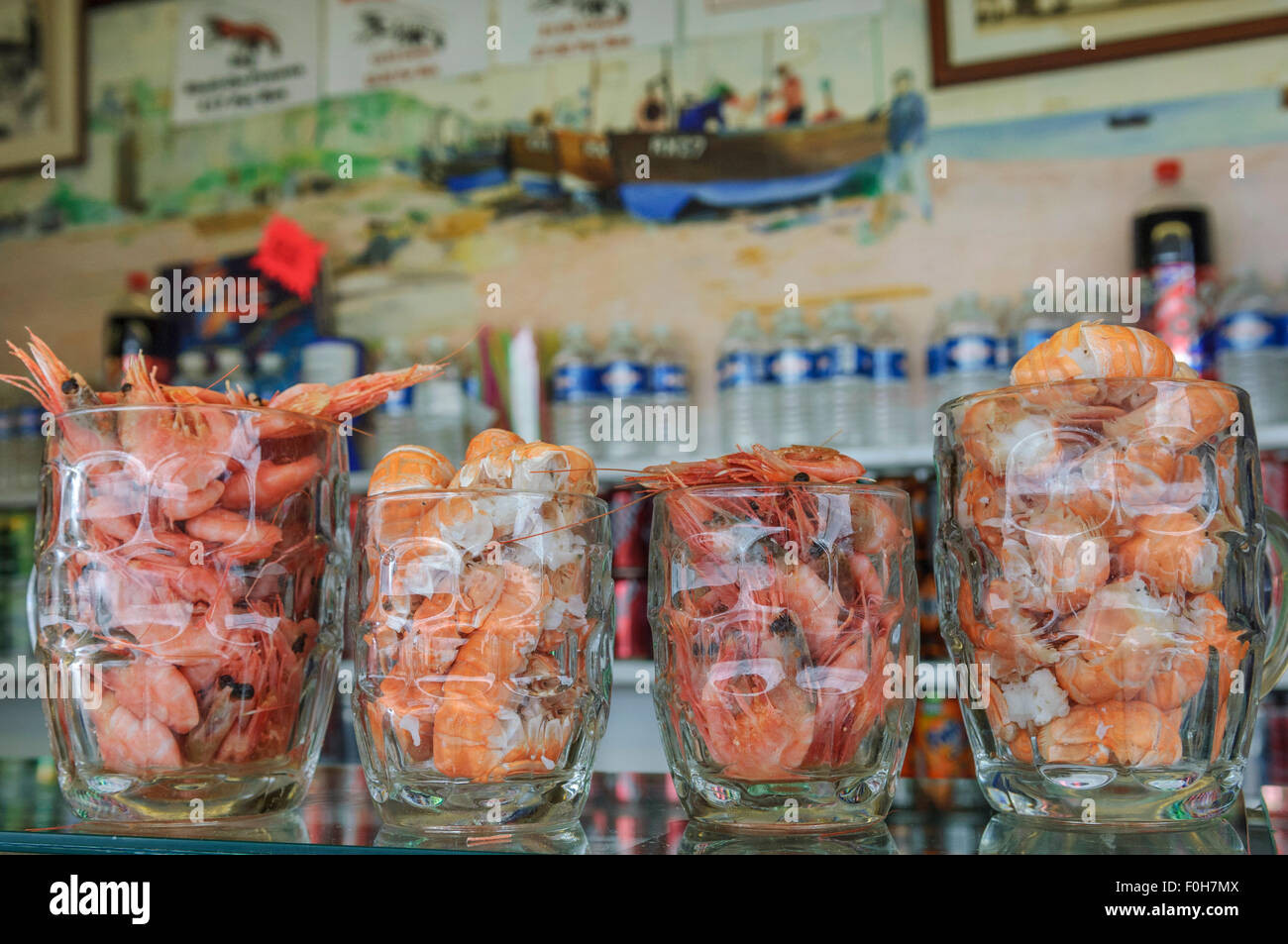 Cooked prawns in pint glasses for sale. The Net Shop seafood bar. Rock-a-Nore. Old Town. Hastings. - Stock Image