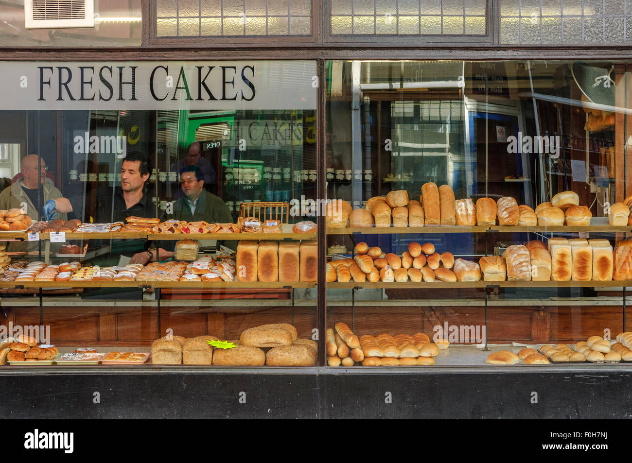 Window display in a traditional bakery. St Leonards on Sea, East Sussex, England. UK - Stock Image