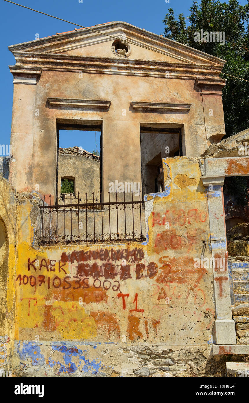 Buildings on the Greek island of Symi highlighting recent austerity issues - Stock Image