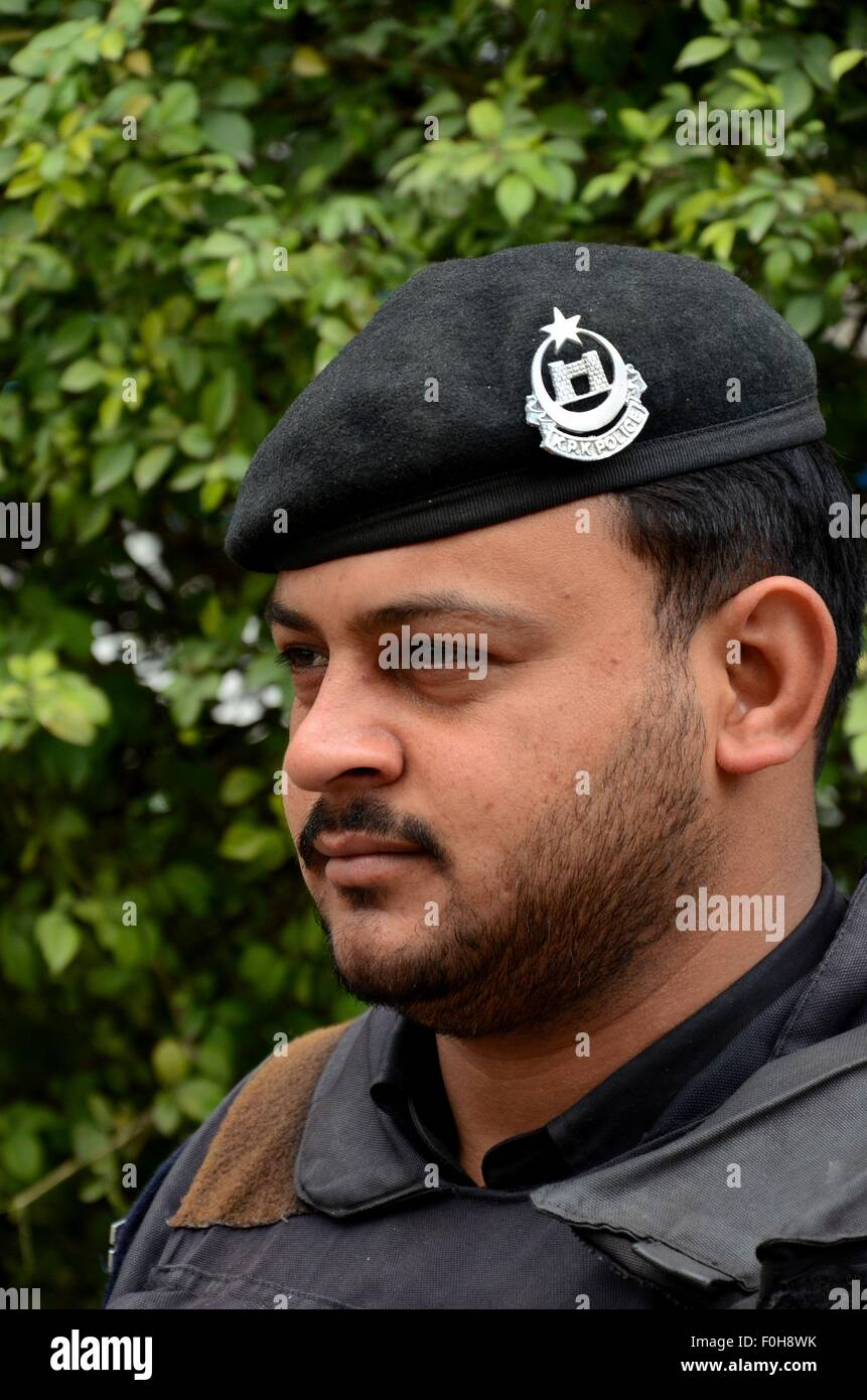 Bearded Pakistani police officer with beret Peshawar Pakistan - Stock Image
