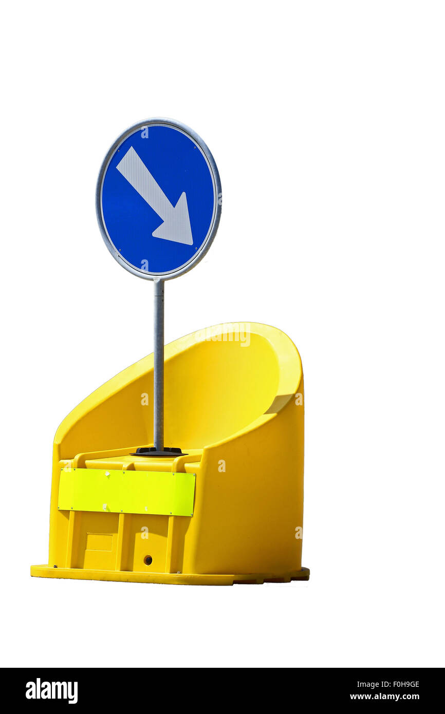 Round blue road sign on yellow bumper isolated on white - Stock Image