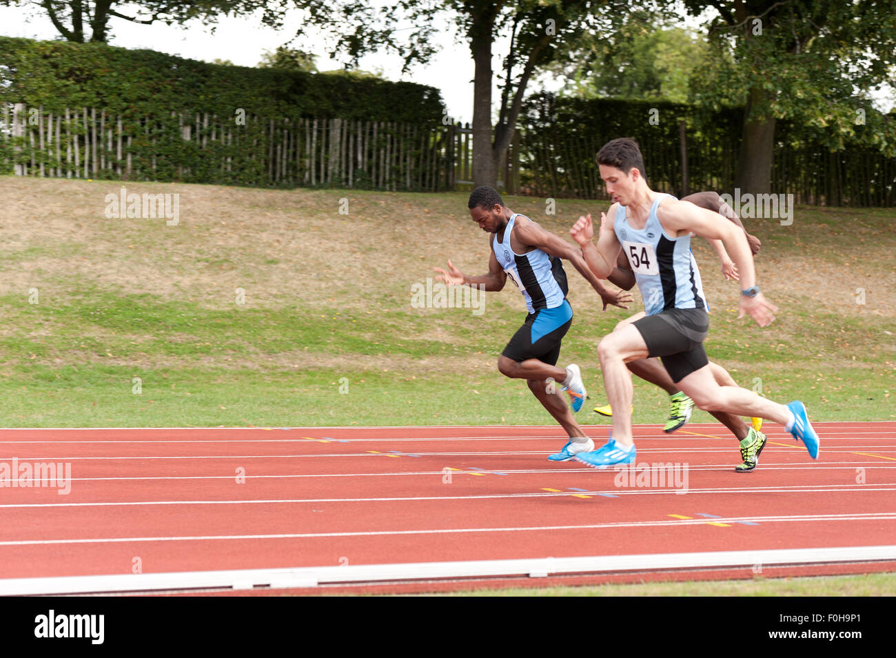 Sport for all 100m male sprint hundred meters race running at high speed athletes sprinters competing on track and - Stock Image