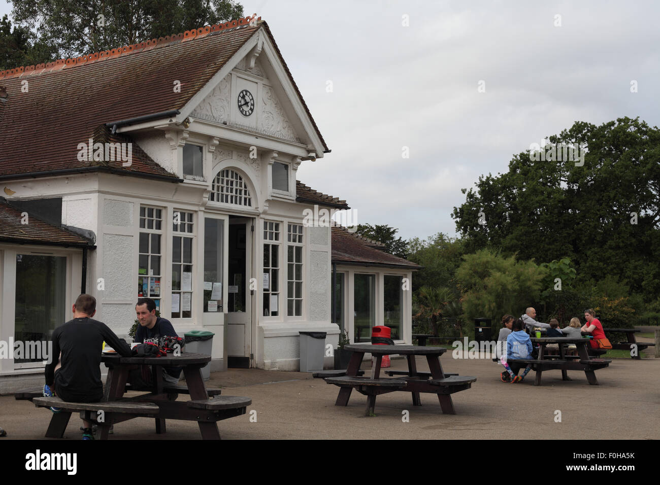 Young dads meeting for breakfast at the Pavillion Cafe, Dulwich Park, London SE21 - Stock Image