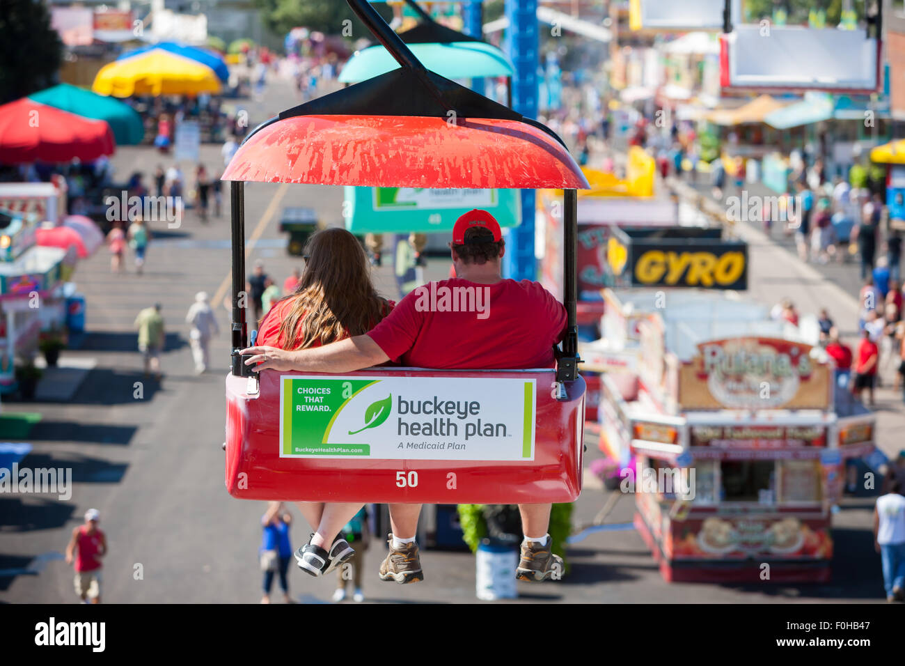 A couple enjoys the view from the Sky Glider high over the midway at the Ohio State Fair in Columbus, Ohio. - Stock Image
