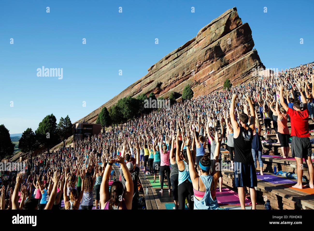 Yoga practitioners, Yoga on The Rocks, Red Rocks Amphitheatre, Morrison, Colorado USA Stock Photo