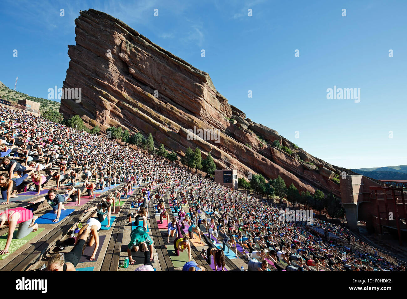 Yoga practitioners, Yoga on The Rocks, Red Rocks Amphitheatre, Morrison, Colorado USA - Stock Image