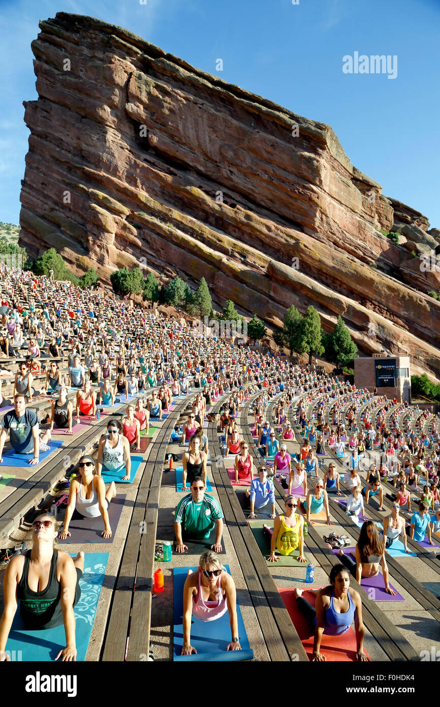Yoga practitioners, Yoga on The Rocks, Red Rocks Amphitheatre, Morrison, Colorado USA Stock Photo