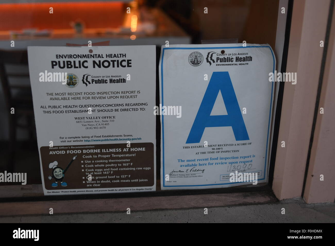 USA California Restaurant A rating public health notice posted in business front window in Encino CA - Stock Image