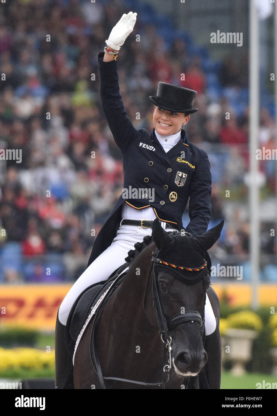 Kristina Broering-Sprehe of Germany gestures on her horse