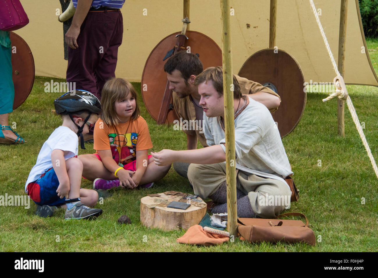 Anglo Saxon and Viking re-enactment  man doing a demonstration for young children at Cannock Chase Visitor Centre - Stock Image