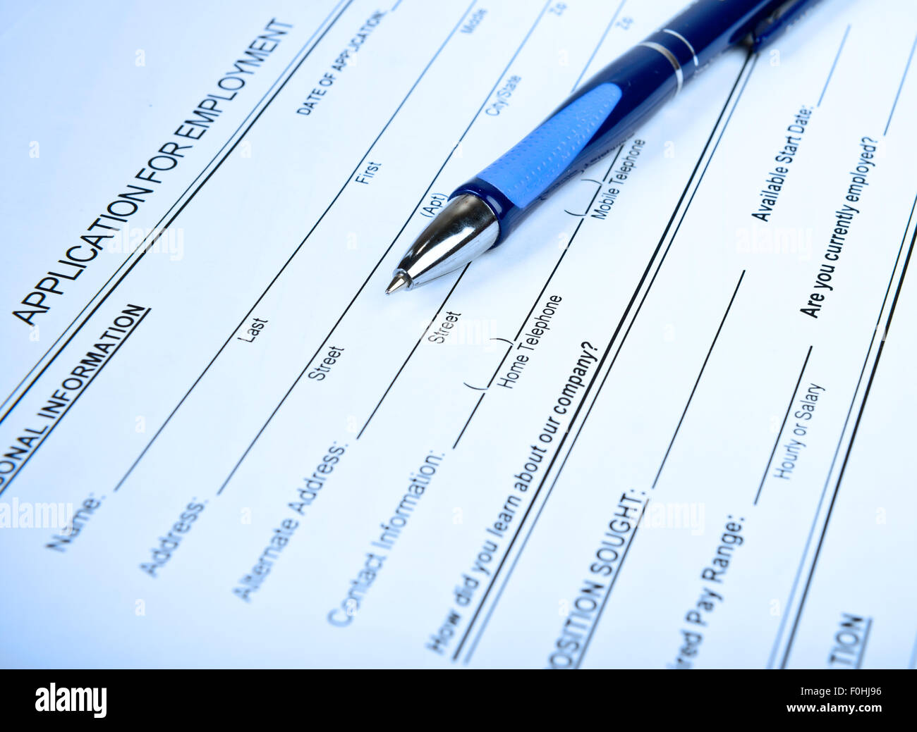 Application for employment toned in blue - Stock Image
