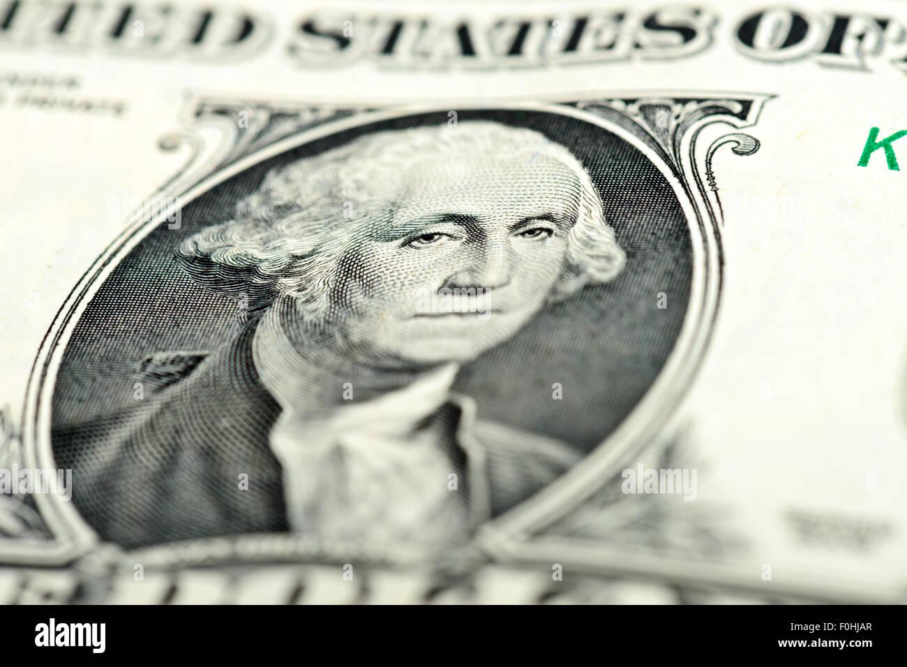 One dollar bill fragment macro Washington eyes - Stock Image