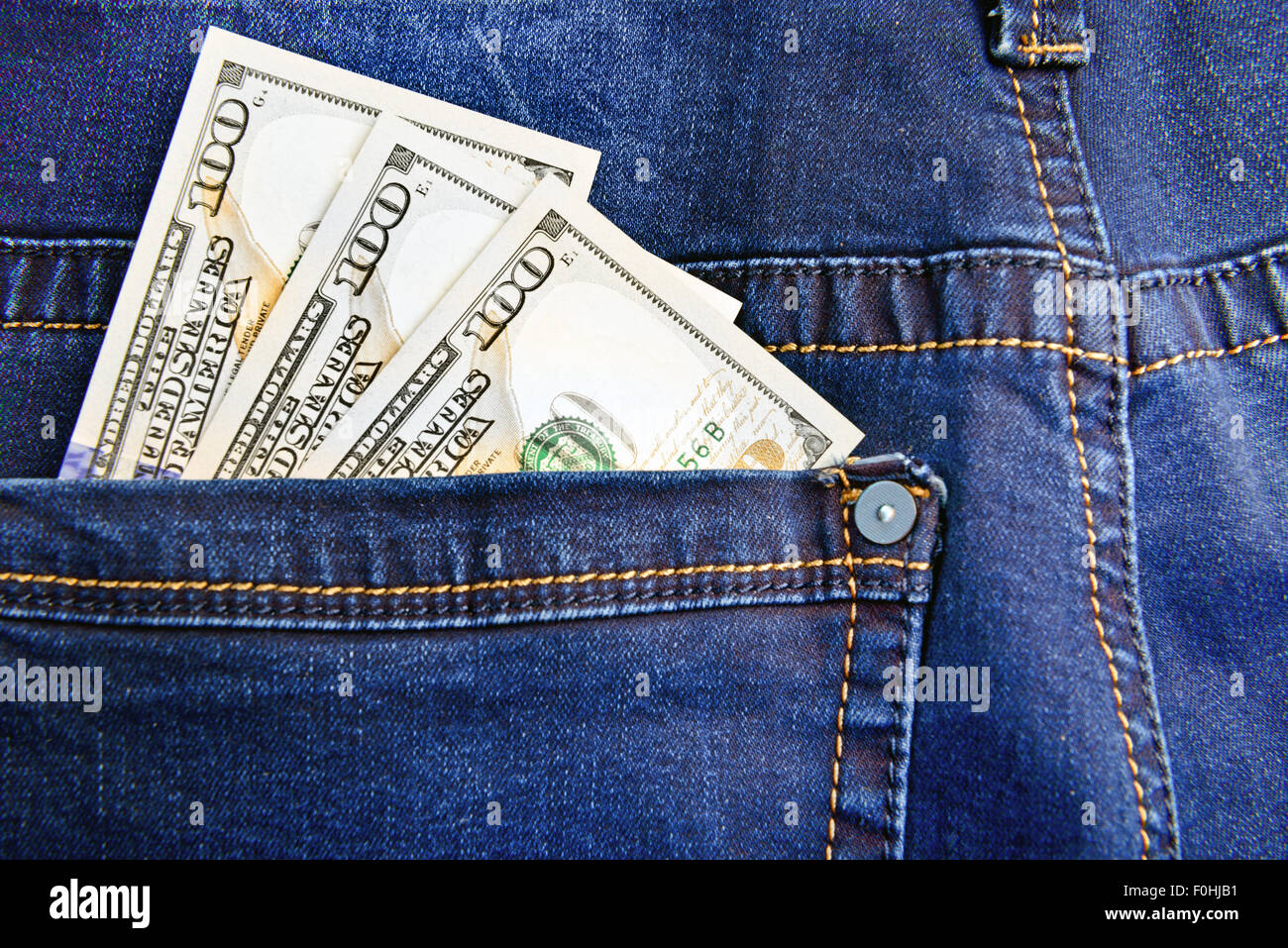 Money in the pocket of jeans - Stock Image