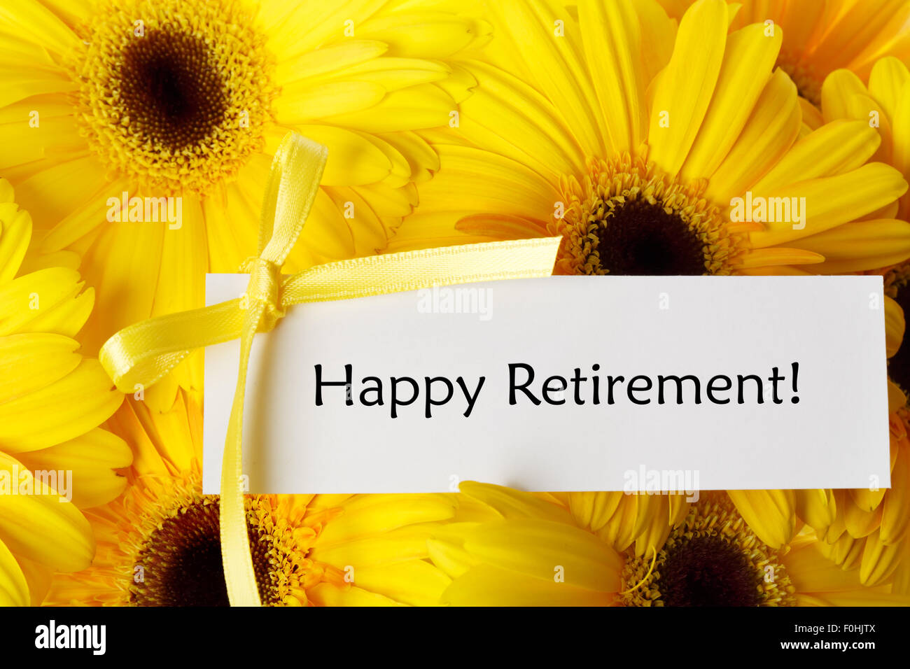 Happy retirement greeting card stock photos happy retirement happy retirement message card with yellow gerberas stock image m4hsunfo