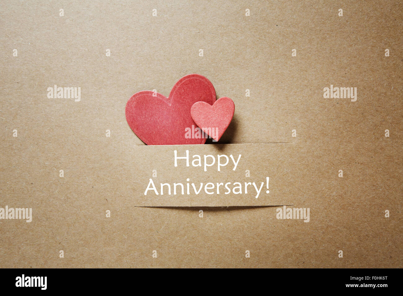 happy anniversary message with handmade red small hearts stock photo
