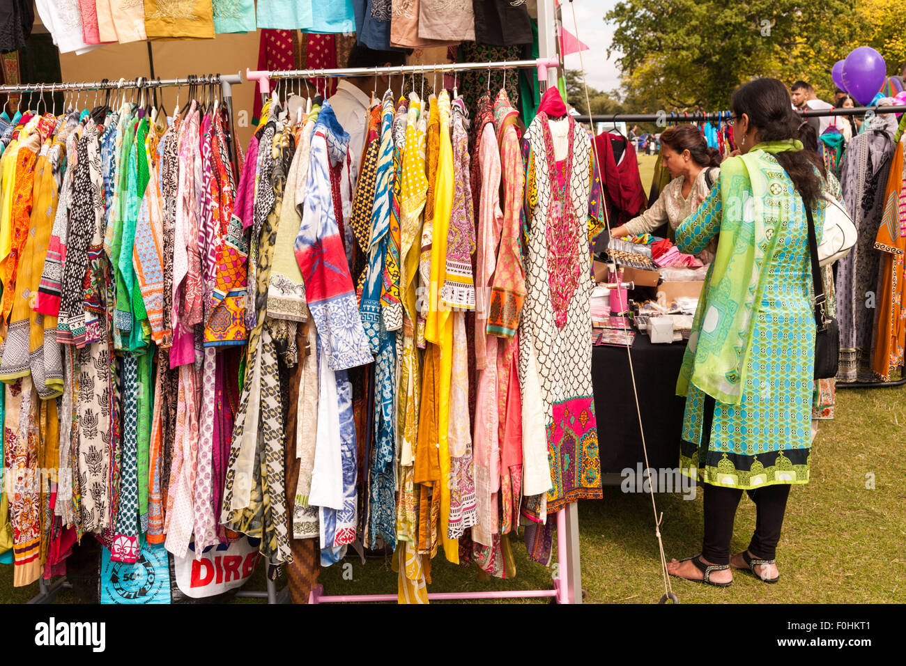 Asian Indian or Pakistani women's clothes on a rack for sale in an outdoor event, Birmingham UK Stock Photo