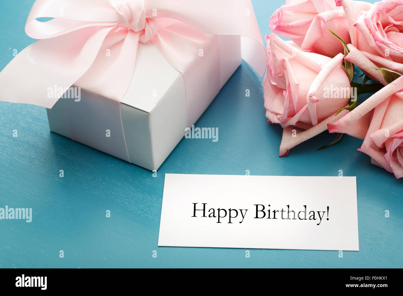 Happy birthday message card with gift box and pink roses stock photo happy birthday message card with gift box and pink roses bookmarktalkfo Image collections