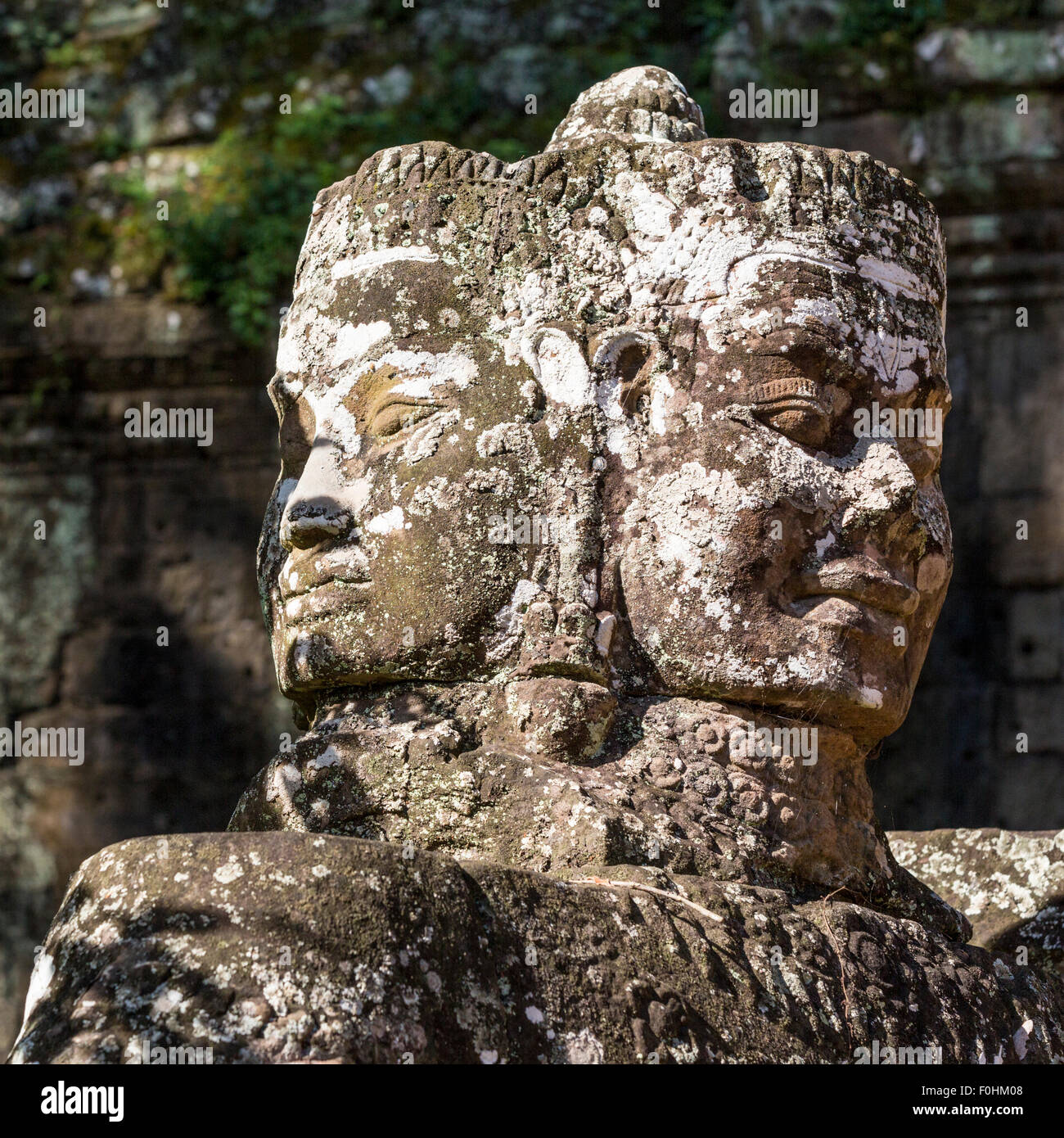 Multi-headed statue at Victory Gate to Angkor Thom complex near Angkor Wat in Siem Reap Cambodia - Stock Image