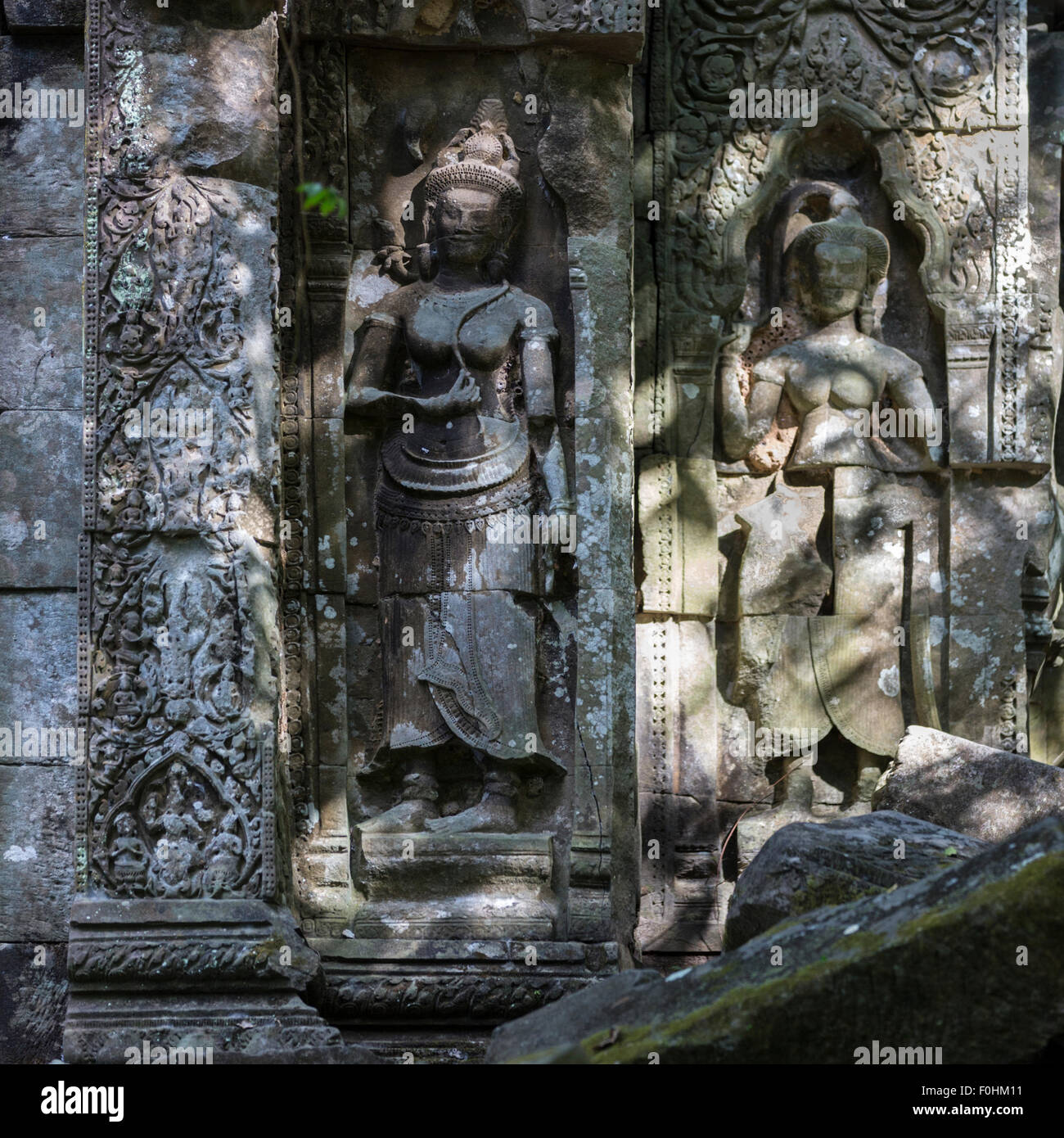 Apsara reliefs in Koh Ker, a Khmer archaeological site 2.5 hours north of Siem Reap and Angkor Wat in Cambodia. - Stock Image