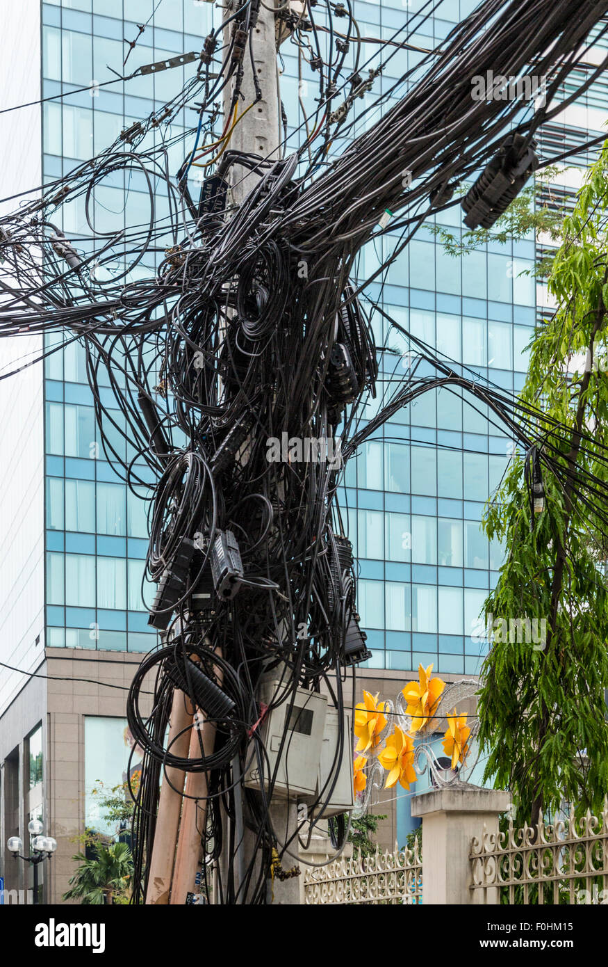 Tangle of wires on a telephone pole in Ho Chi Minh City (Saigon ...