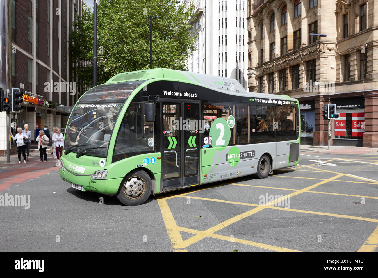 free metro shuttle bus green route two in Manchester city centre England UK - Stock Image