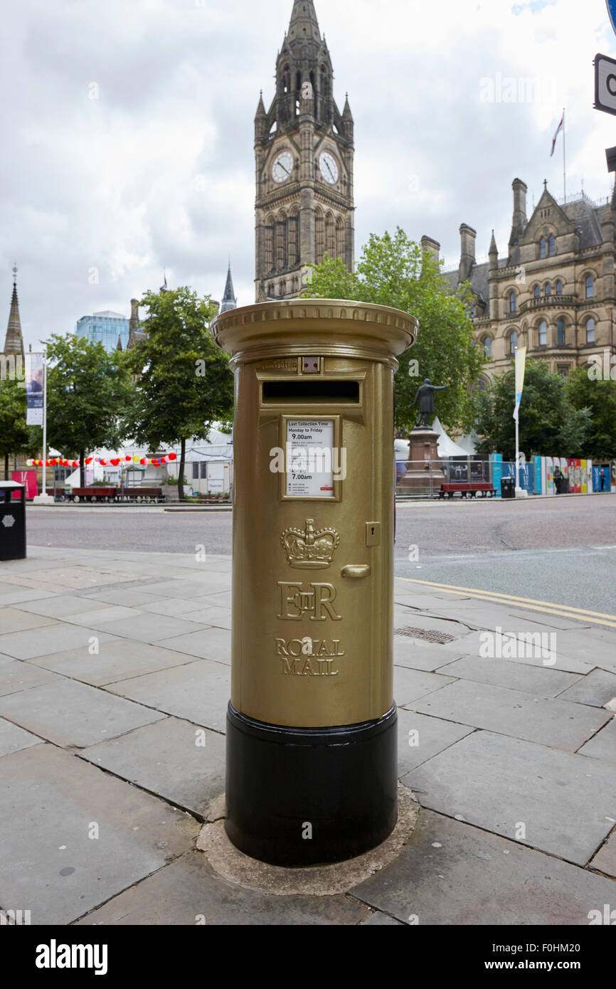 gold painted postbox signifying olympic gold medals in albert square Manchester England UK - Stock Image