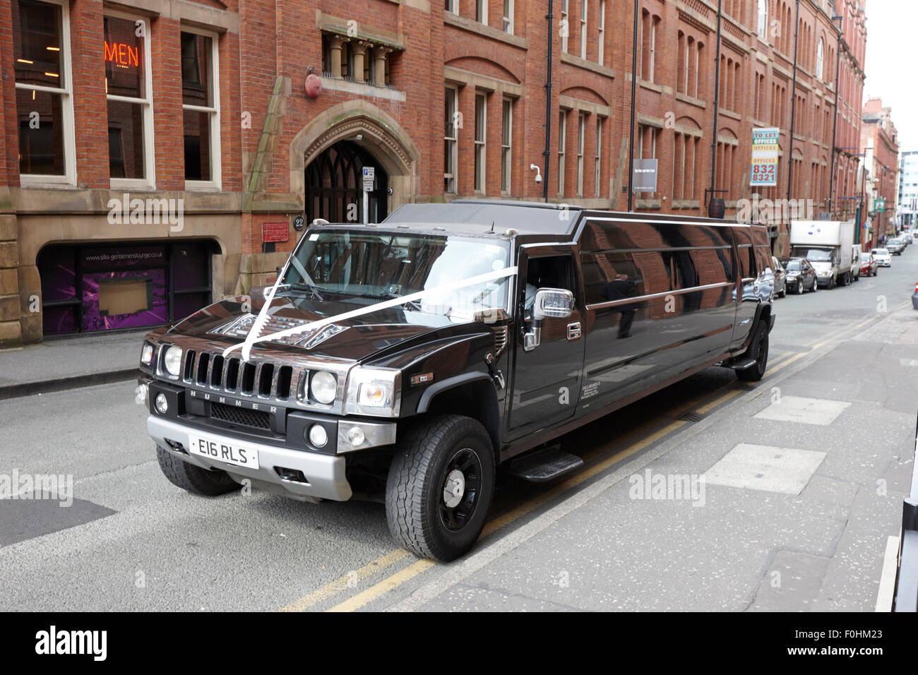 stretch hummer limo as a wedding car Manchester England UK - Stock Image
