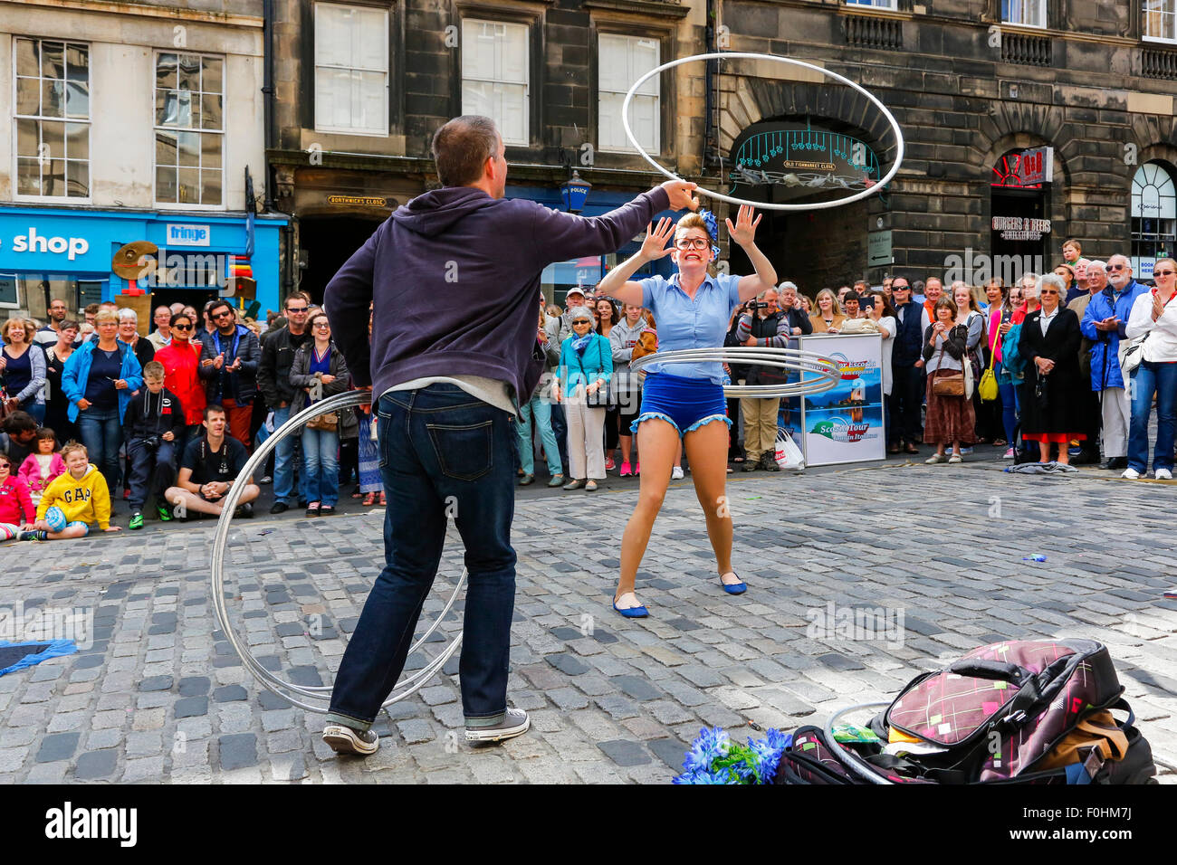 Acrobat called 'Maples' performing with hoola hoops in The Royal Miler, Edinburgh at the Fringe Festival, - Stock Image