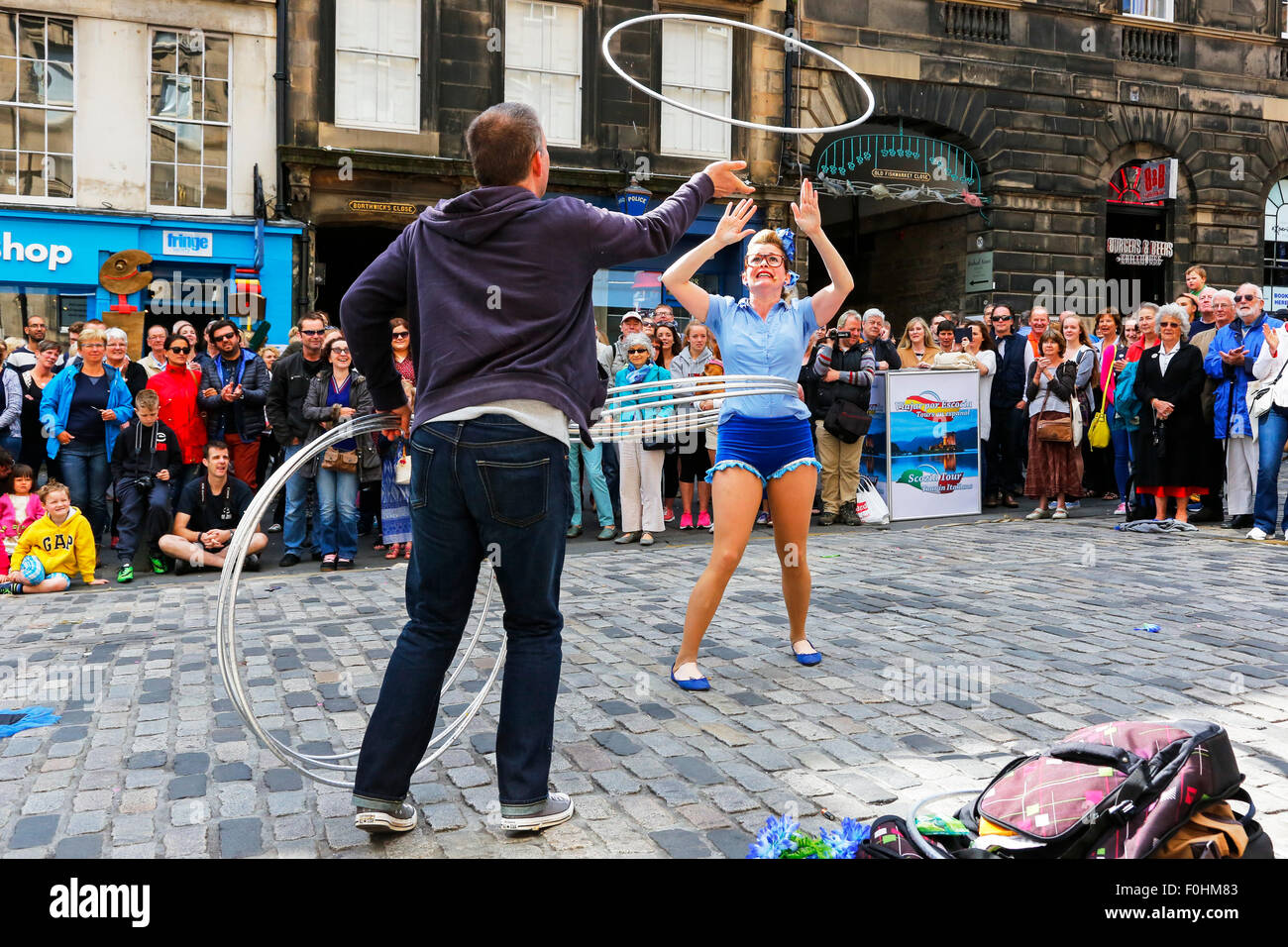 Acrobat called 'Maples' performing with hula hoops in The Royal Miler, Edinburgh at the Fringe Festival, - Stock Image