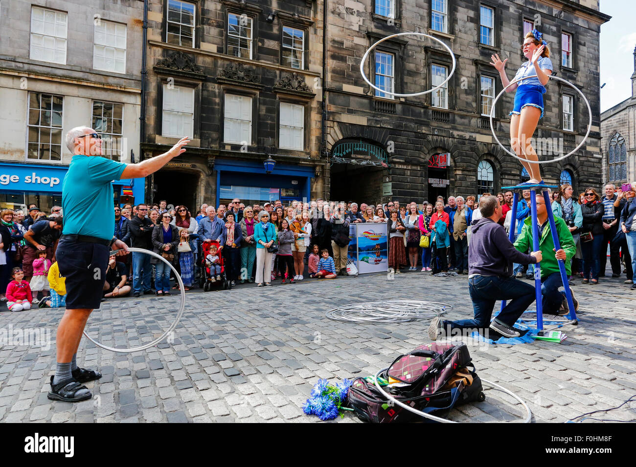 Acrobat called 'Maples' performing with hula hoops in The Royal Mile, Edinburgh at the Fringe Festival, - Stock Image