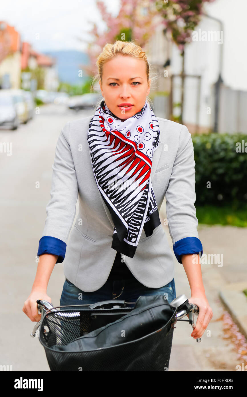 Woman riding bicycle. - Stock Image