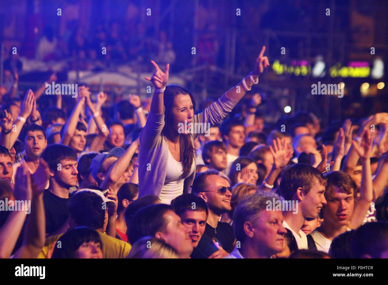 KYIV, UKRAINE - JUNE 30, 2012: People dance during Queen performs onstage at charity Anti-AIDS concert at the Independence - Stock Image