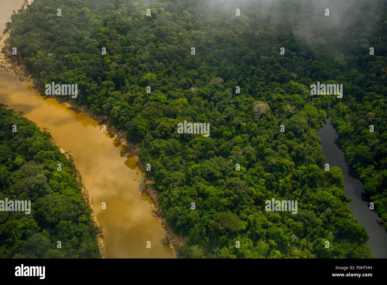 Amazon Rainforest aerial. Primary forest, Yavari Miri River and oxbow lake, between Iquitos, Peru and Brazilian - Stock Image