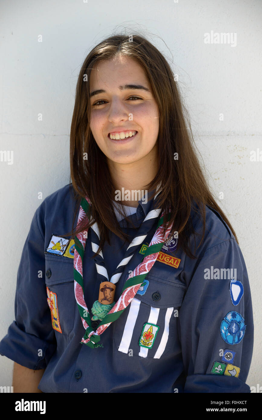 Portrait of a girl scout wearing her scouting uniform with honor patches and neckerchief - Stock Image