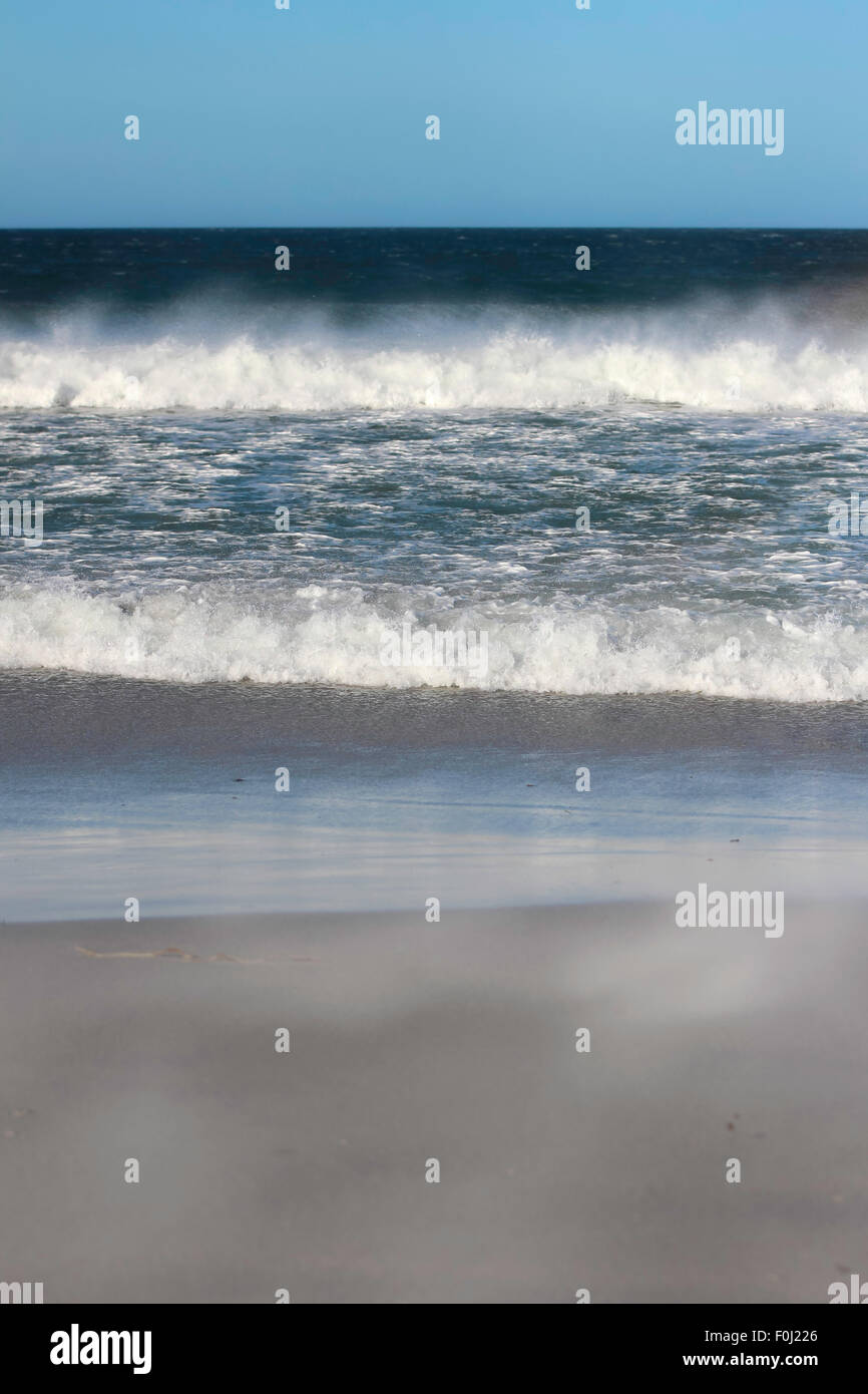 Waves breaking on the shore Bertha's Beach. Falkland Islands. - Stock Image