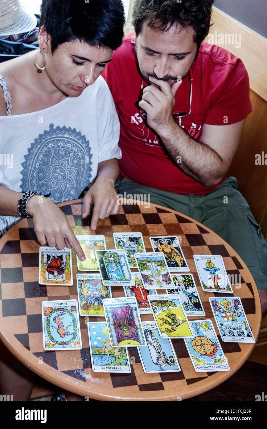 Madrid Spain Europe Spanish Plaza de Atocha Hispanic man woman couple predicting future mysticism divination New - Stock Image
