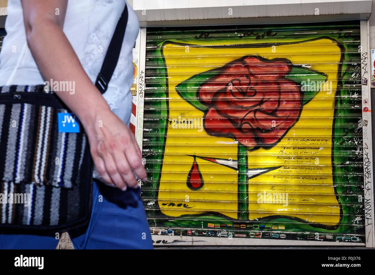 Madrid Spain Europe Spanish Centro Lavapias Calle de Zurita mural rose thorn blood pedestrian - Stock Image