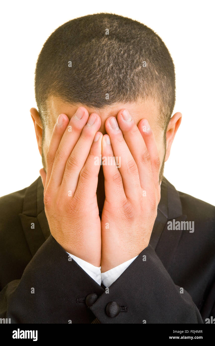 Ashamed Business Man Hiding His Face With His Hands Stock