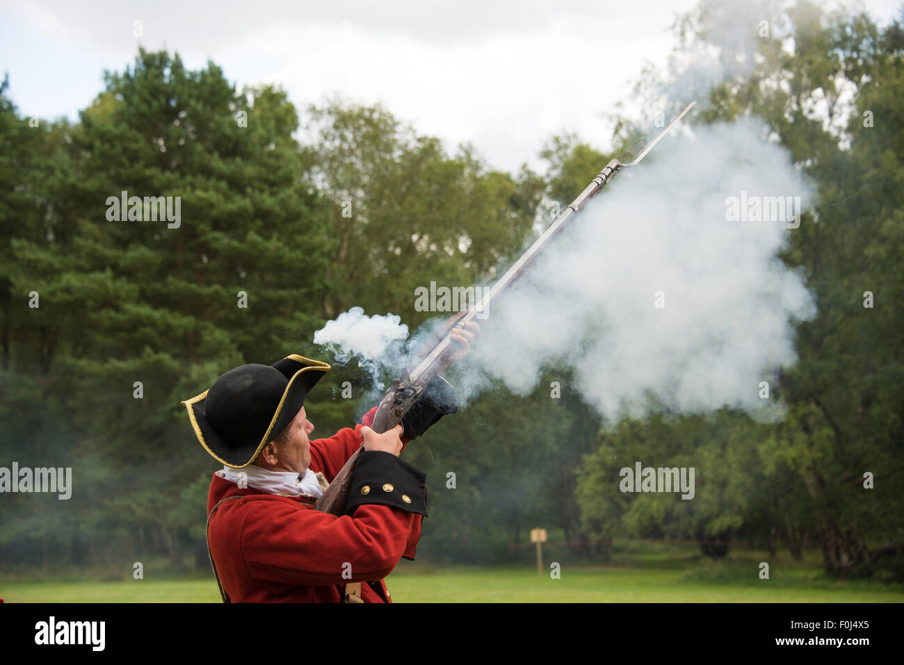 French military soldiers firing a musket during  18th Century Jacobite era re-enactment at Cannock Chase Visitor Stock Photo