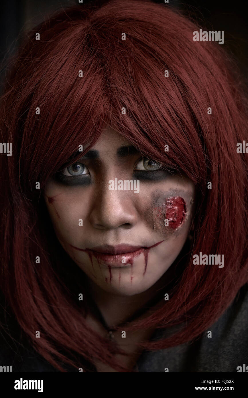 Zombie Female Piercing Eyes And Face Make Up Of A Female Zombie