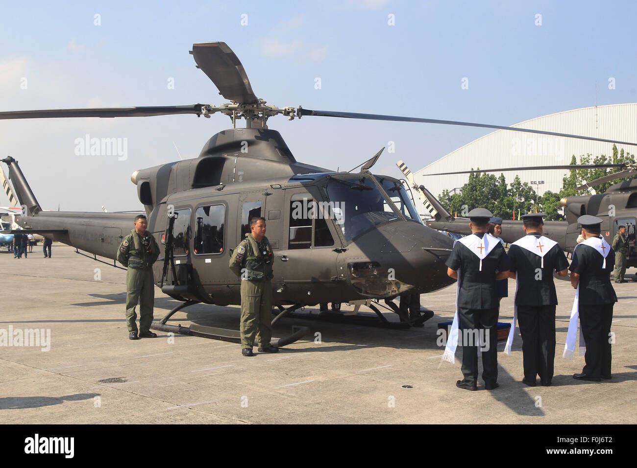 Pasay City, Philippines. 17th Aug, 2015. Military chaplains bless a newly-acquired Bell-412EP helicopter during - Stock Image