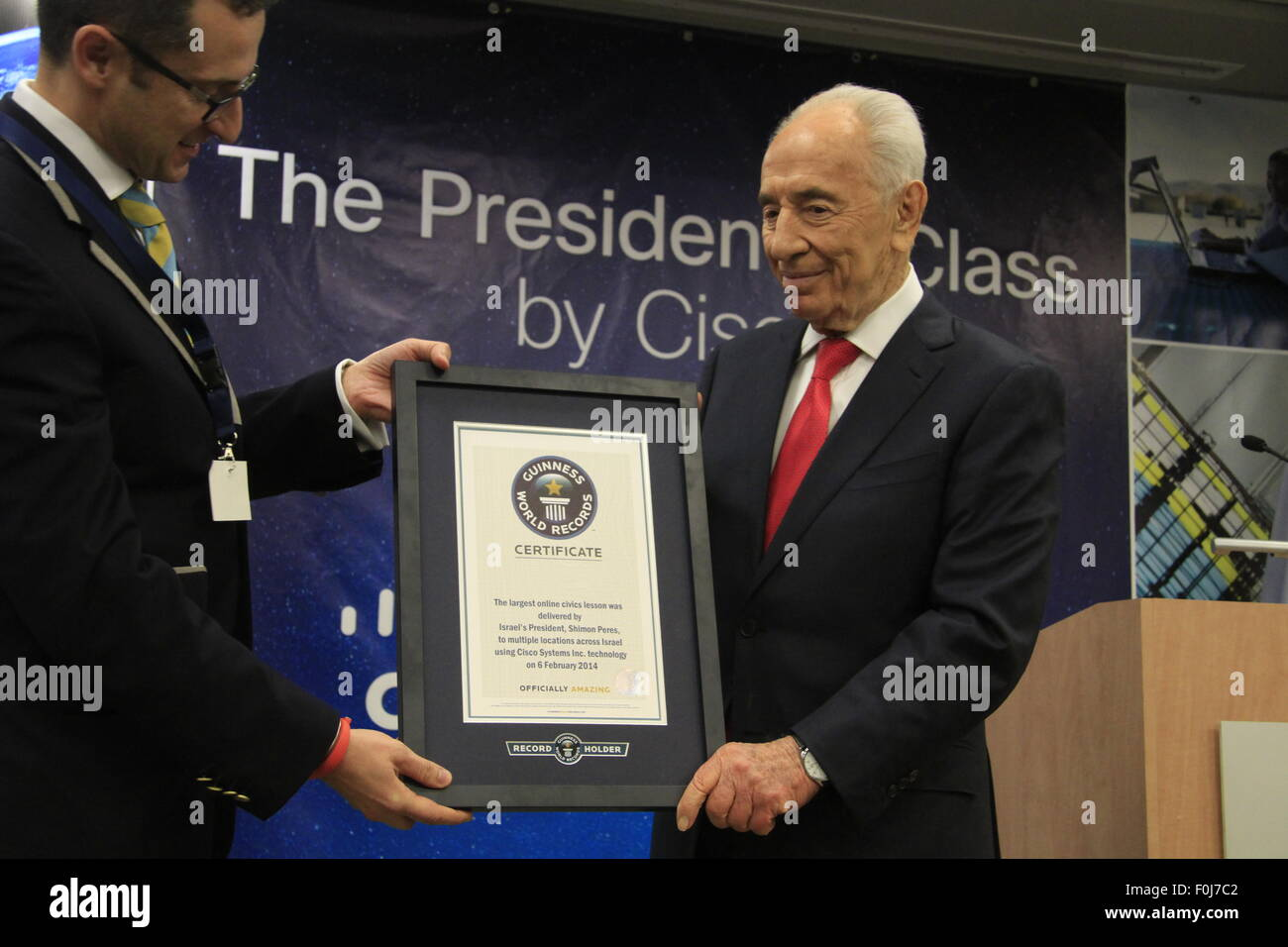 President Peres receives the Guinness World Record Holder card from Senior Vice President of Guinness World Records, - Stock Image