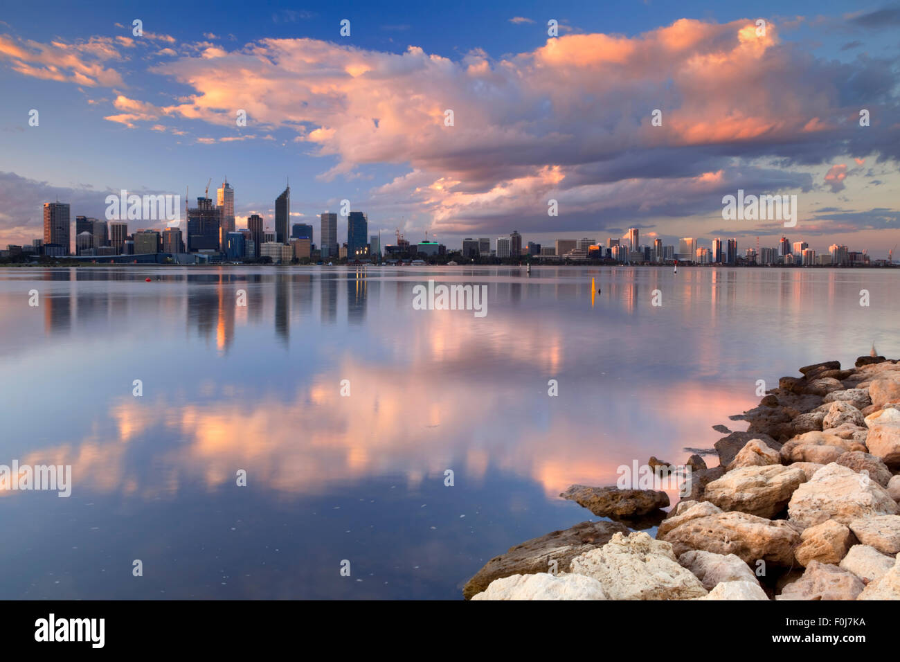 The skyline of Perth, Western Australia at sunset. Photographed from across the Swan River. - Stock Image